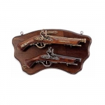 Medieval - Firearms - Flintlock pistols, Old Guns - Panel in shaped wood, provided with two metal rings to hang it from the wall, it holds the not fireable reproductions of two flintlock pistols: the lower is a XVIII century model, size 45 X 25 cms.