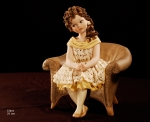 Sibania Porcelain Figurines - Porcelain sculpture depicting little girl sitting, Clara, height 25 cm (9.8 in), Wonderful porcelain sculpture, entirely handmade in Italy.