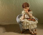 Sibania Porcelain Figurines - Porcelain sculpture depicting little girl sitting, Costanza, height 28 cm (11 in), Wonderful porcelain sculpture, entirely handmade in Italy.