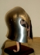 Armours - Medieval Helmets - Sallet to Venetian, attached to the head marked by a rib midway between the hairline and neck.