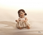 Sibania Porcelain Figurines - Porcelain sculpture depicting little girl sitting, Eva, height 5.5 cm (2.2 in), Wonderful porcelain sculpture, entirely handmade in Italy.
