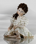 Sibania Porcelain Figurines - Porcelain sculpture depicting little girl sitting, Evelina, height 17 cm (6,7 in), Wonderful porcelain sculpture, entirely handmade in Italy.