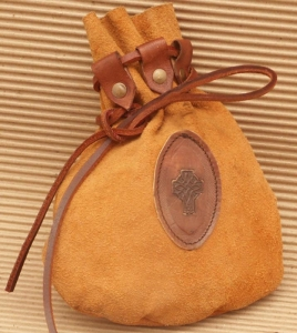 Pouch Medieval, Medieval - Medieval Objects - Medieval Objects - Pouch Medieval made of light leather is closed with a strong leather strap, which is drawn through the riveted plates Size: 15 x22 cm.