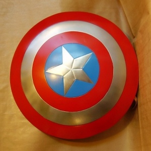 Captain America  metal shield, THE WORLD OF CINEMA - Captain America metal shield is crafted from metal, it measures approximately 23 1/4-inches in diameter. The Captain America Shield is made of steel making it fully functional. Like Captain America's real shield it is slightly concave.